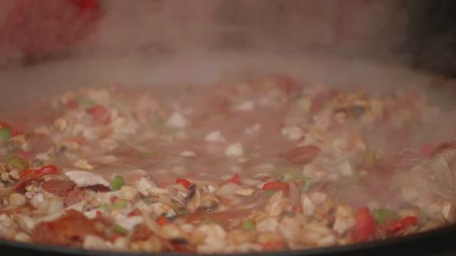 cooking chicken paella in Christmas market,Belfast,Northern Ireland video