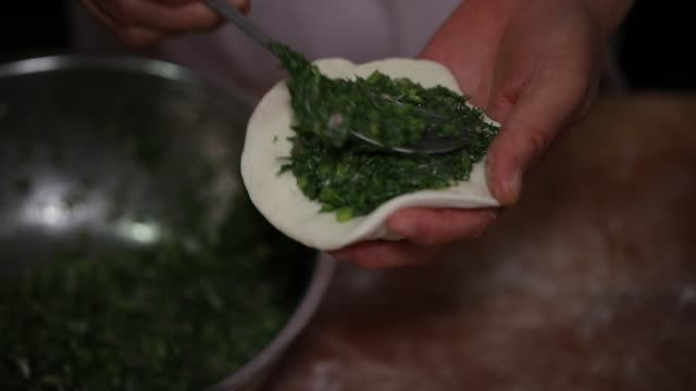 cooking chinese bun(baozi) - chinese food stock videos and b-roll footage
