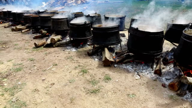 Cooking food in nature on the cauldron video
