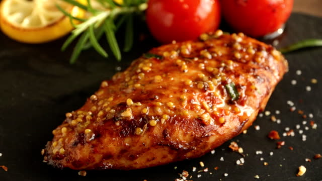 cooking fried roasted chicken breasts cut knife with lemon tomato and rosemary mustard seeds honey cooking fried roasted chicken breasts cut knife with lemon tomato and rosemary mustard seeds honey cooked stock videos & royalty-free footage