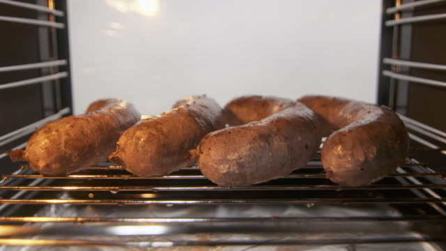 Cooking grilled sausage in electric oven roasting rack with pork sausages Cooking grilled sausage in electric oven roasting rack with pork sausages inside convection oven. roast dinner stock videos & royalty-free footage