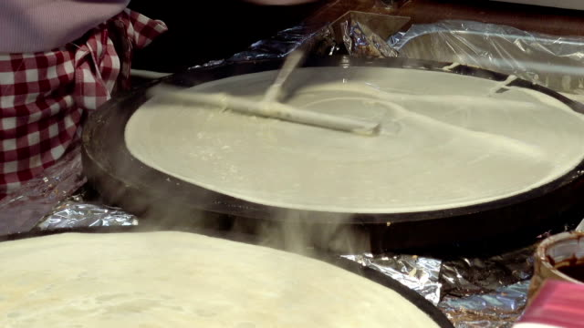 Cooking hot sweet pancakes on the street Cooking hot sweet pancakes on the street kitchen. Street food is popular for snack or lunch in big cities. cooking utensil stock videos & royalty-free footage