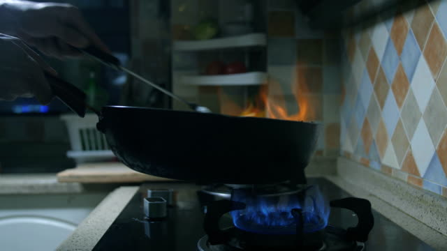 Cooking in Flaming Pan Cooking in Flaming Pan stir fried stock videos & royalty-free footage