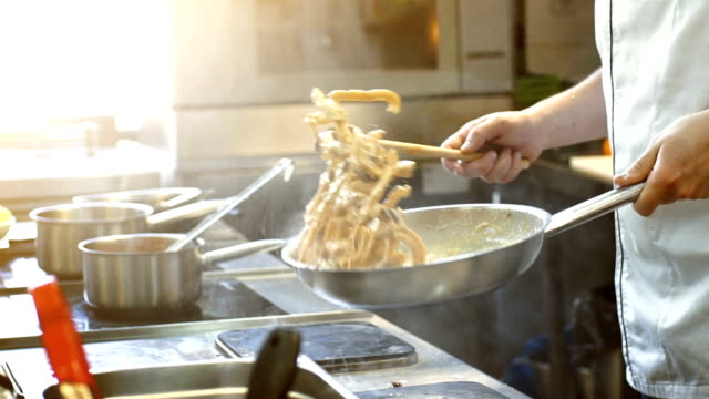 cooking in slow motion. - acciaio inossidabile video stock e b–roll