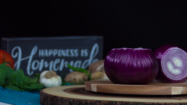Cooking ingredients - Onion Beautiful slow motion shot of cooking ingredients - Onions on a rotating board red onions stock videos & royalty-free footage