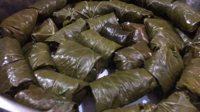 cooking national dish dolma - cucina francese video stock e b–roll