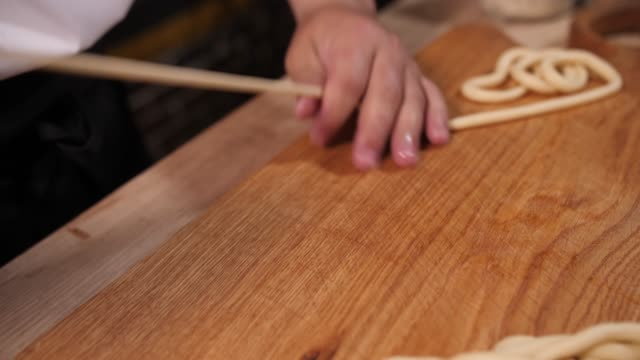 cooking noodles manually from dough cooking noodles manually from dough macaroni stock videos & royalty-free footage