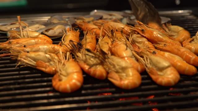 Cooking of grilled fresh tiger prawn video