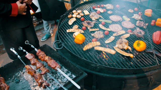 Cooking of Meat and Vegetables on the Grill video