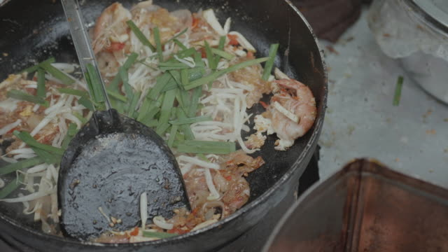 Cooking of Pad Thai, street food and at casual local eateries in Thailand.