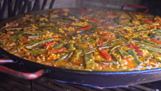 Cooking paella Real time video of cooking paella. spice stock videos & royalty-free footage