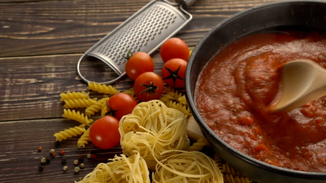 Cooking pasta sauce Cooking pasta sauce in pan spaghetti stock videos & royalty-free footage
