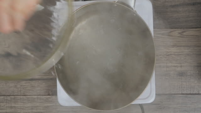 cooking penny pasta  in hot pot top view of cooking penny pasta  in hot pot boiled stock videos & royalty-free footage