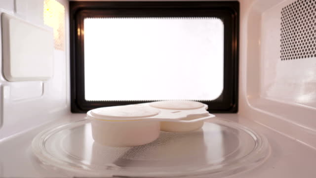 Cooking poached eggs with two cup egg poacher in the microwave oven video