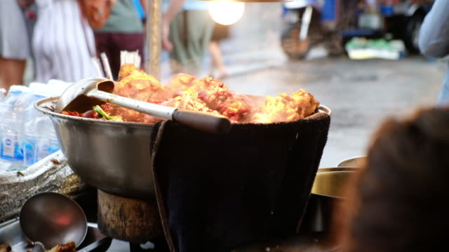 Cooking pork stewed in the sweet gravy, Chinese-Thai cuisine. video