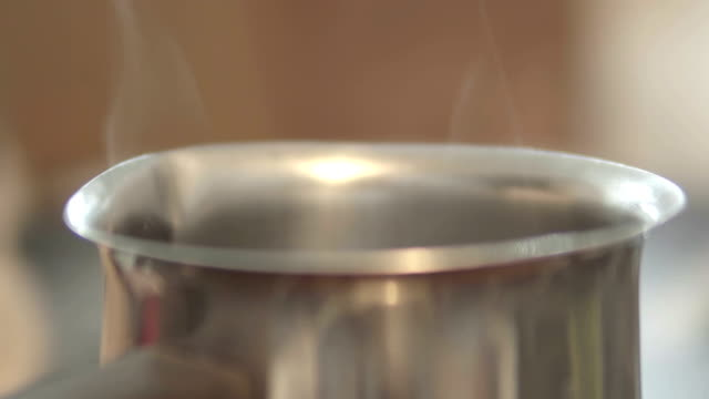 Cooking Pot and cook steams, cinematic dof video