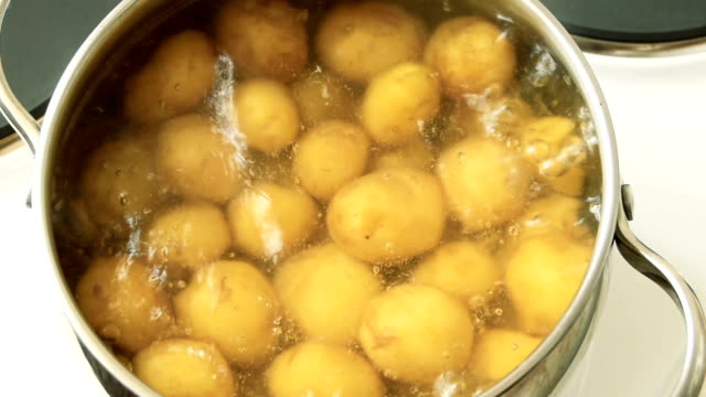 Cooking potatoes, closeup Boiling potatoes in casserole, closeup, top view prepared potato stock videos & royalty-free footage