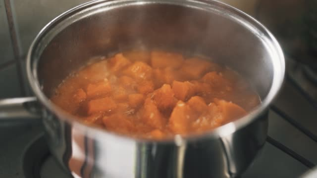 cooking pumpkin in a stainless steel saucepan slow motion - pumpkin stock videos & royalty-free footage