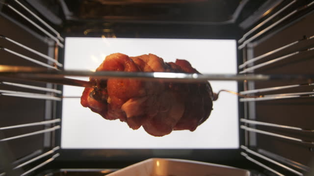 Cooking rotisserie roast pork neck in hot convection oven video