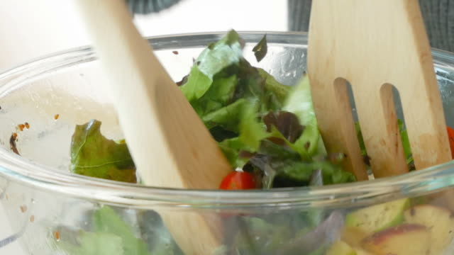 cooking salad , zoom out - insalata video stock e b–roll
