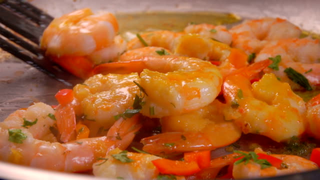 Cooking shrimp in a frying pan Cooking shrimp in a frying pan. Circular motion of the camera shrimp seafood stock videos & royalty-free footage