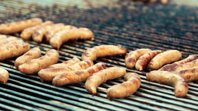 Cooking / smoking delicious juicy meat steaks ans sausages on the grill video