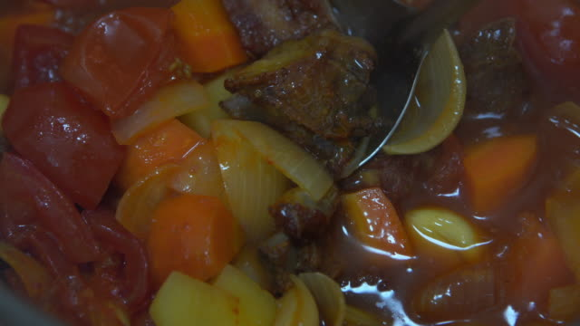 POV , Cooking stewed , spare-ribs potato onoin with tomato sauce