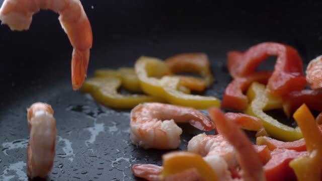 Cooking stir fry in slow motion Cooking stir fry in slow motion; shot on Phantom Flex 4K at 1000 fps shrimp seafood stock videos & royalty-free footage
