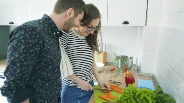 cooking together at home. - приготовление еды стоковые видео и кадры b-roll
