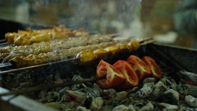 cooking traditional turkish adana kebab on grill - cultura turca video stock e b–roll
