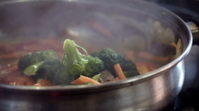 Cooking vegetables in saucepan, close up video