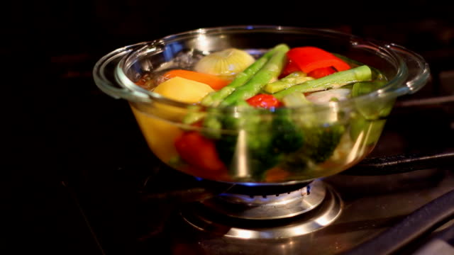 cooking  vegetables in transparent glass pot video
