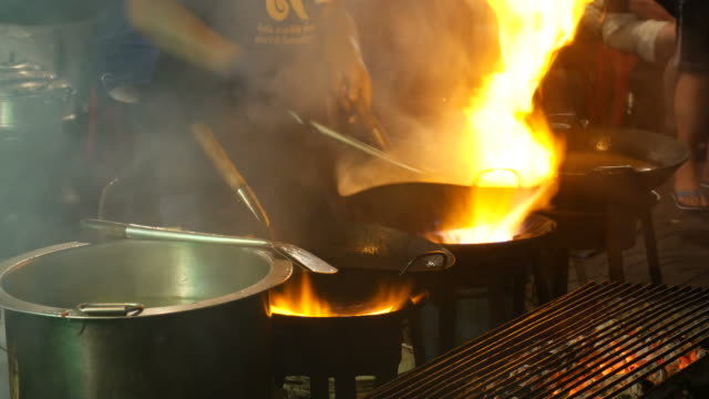 Cooking with wok, street food, Thailand video