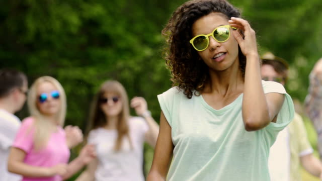 Cool clip, biracial singer dancing and flirting at camera, summertime and party video
