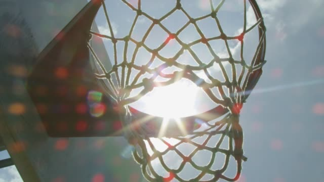 Cool close-up with sun rays of a basketball net video