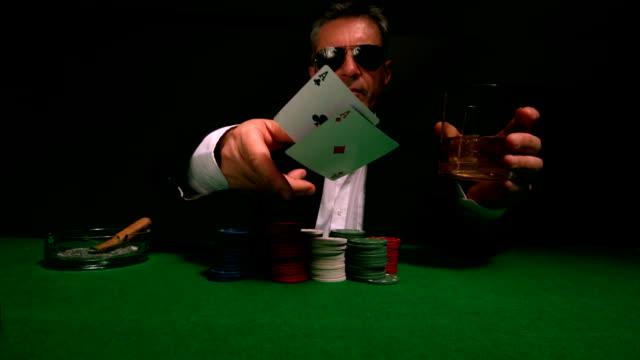 Cool gambler throwing cards to camera video