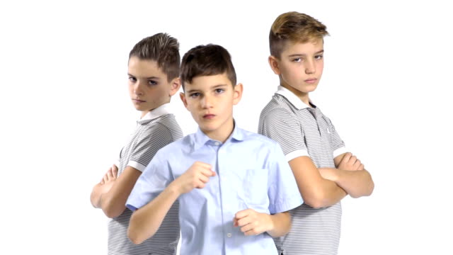 Cool gang of three little brothers at white background video