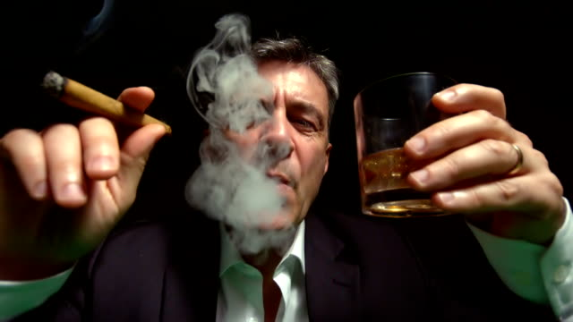 stockvideo's en b-roll-footage met cool mature man smoking a cigar - guy with cigar