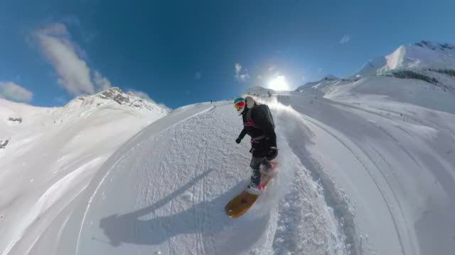 360vr: cool snowboarder girl riding off trail down the steep snowy mountain. - snowboarding video stock e b–roll