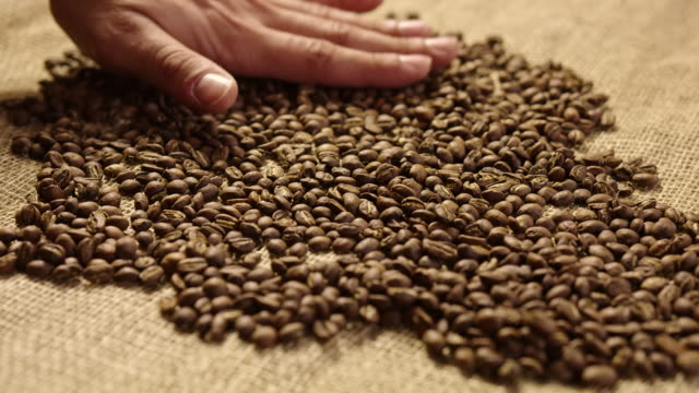 Cooling coffe beans 4K slow motion video
