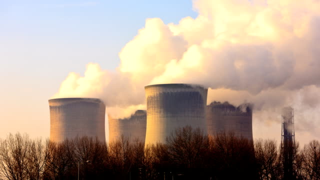Cooling towers billowing steam video