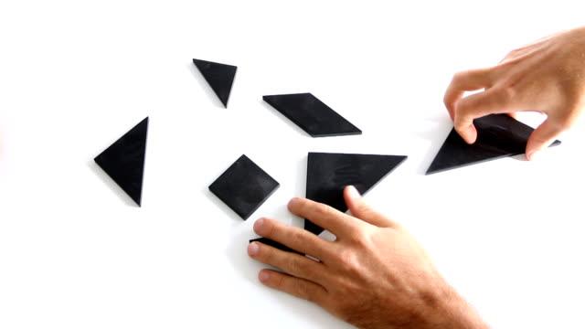 la cooperazione - puzzle video stock e b–roll