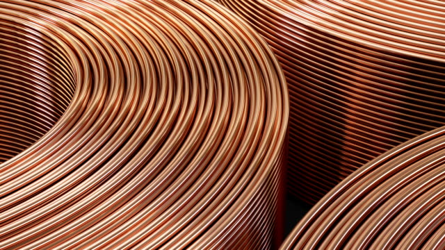 Copper pipes close-up. Coils with tubes in warehouse.