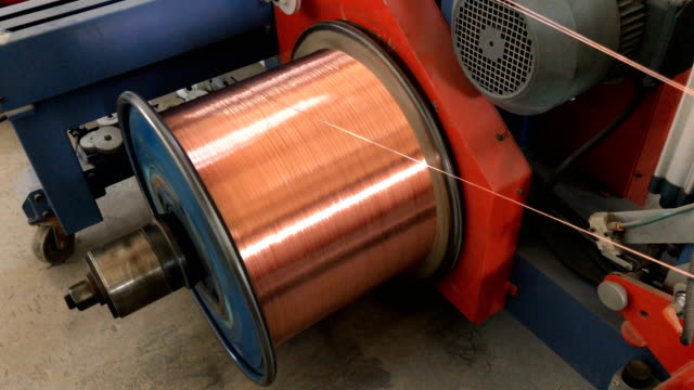 Copper wire winding to spool Copper wire winding to spool in a cable factory copper stock videos & royalty-free footage