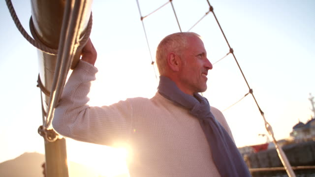 Copy space shot of senior yacht captain at sunset video