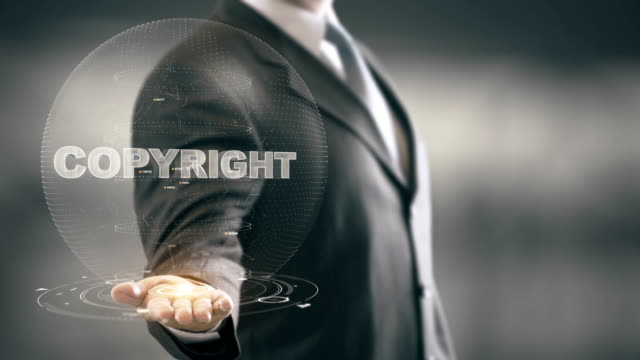copyright technology businessman holding in hand new technologies - proibizione video stock e b–roll