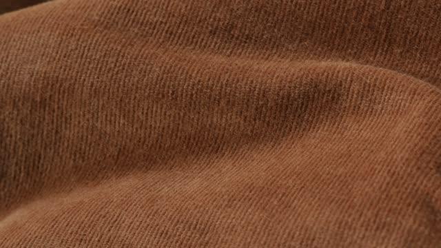 Corduroy striped brown pants fabric slow tilt