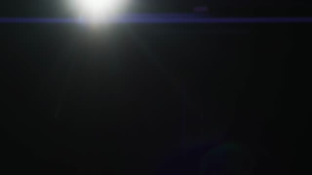 Corner Light Growing and Subsiding on the Black Background. Real Lens Flare with Anamorphic Effect. FX Special Effect. Easy to Use in Blend / Overlay Modes. video