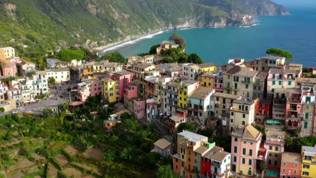 corniglia - village of cinque terre national park at coast of italy. province of la spezia, liguria, in the north of italy - aerial view - travel destination and attractions in europe. - средиземноморская культура стоковые видео и кадры b-roll