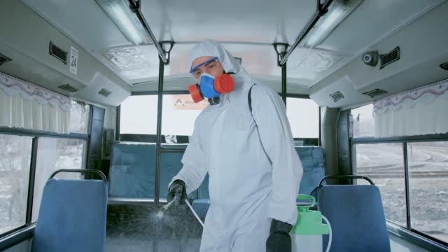 Corona Virus. Man Disinfect Bus. Covid-19. Coronavirus Mers. Spray in Transport. video